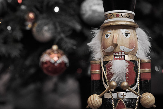 Wooden Nutcracker and decorated x-mas tree decorations