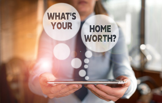 Conceptual hand writing showing What s is Your Home Worth question. Concept meaning Value of a house Property Cost Price Rate Woman in the background pointing with finger in empty space