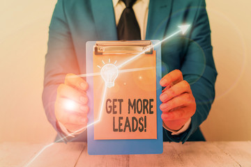 Writing note showing Get More Leads. Business concept for initiation consumer interest or enquiry...