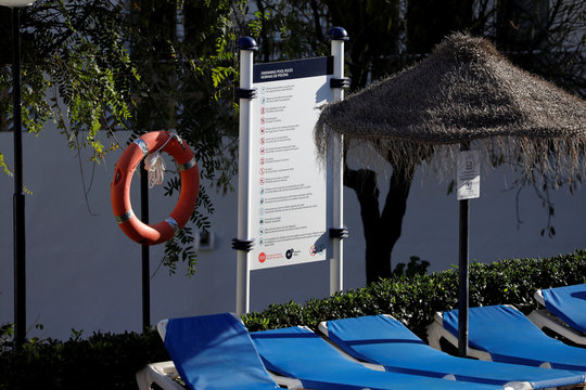 A float is seen at a swimming pool where where three members of the same British family, a father and two children, were found on Christmas Eve at a Costa del Sol resort in Las Lagunas de Mijas