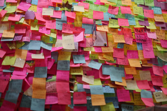 Post-it notes cover the front of a local restaurant offering protesters free Christmas dinner in Hong Kong