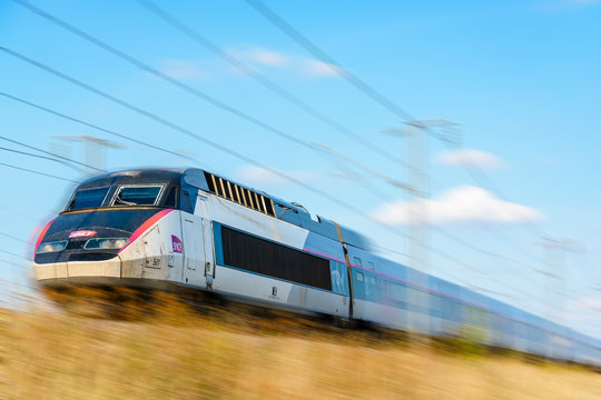 Varreddes, France - August 18, 2018: A TGV high-speed train in Carmillon livery from french company SNCF driving at full speed on the LGV Est, the East European high-speed line (artist's impression).