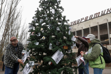 Former residents of Pripyat decorate a Christmas tree in Pripyat