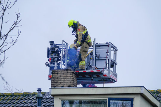 Firefighters extinguishing a chimney fire.