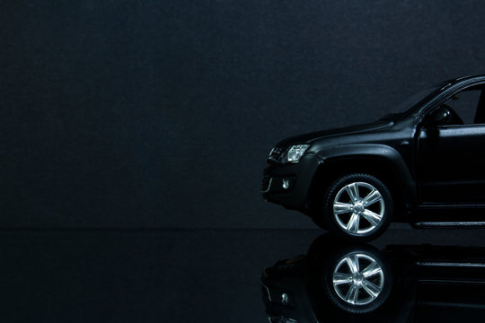 the front of a model copy of the Volkswagen Amarok on a black background and reflective surface.