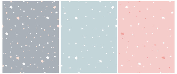 Foto auf Acrylglas Künstlich Tiny Stars Vector Patterns. Irregular Hand Drawn Simple Starry Sky Print for Fabric, Textile, Wrapping Paper. Infantile Style Galaxy Design. Little Stars Isolated on a Gray, Blue and Pastel Pink.