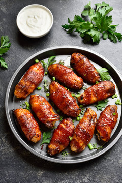 Bacon wrapped grilled chicken wings