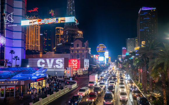 Las vegas nightlife. Illuminated highrise buildings, colorful neon signs and ads