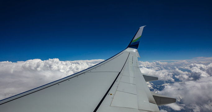 Alaska airlines plane wing over cloudscape. USA