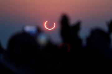 People take photos with their smartphones as they monitor the annular solar eclipse on Jabal Arba (Four Mountains) in Hofuf