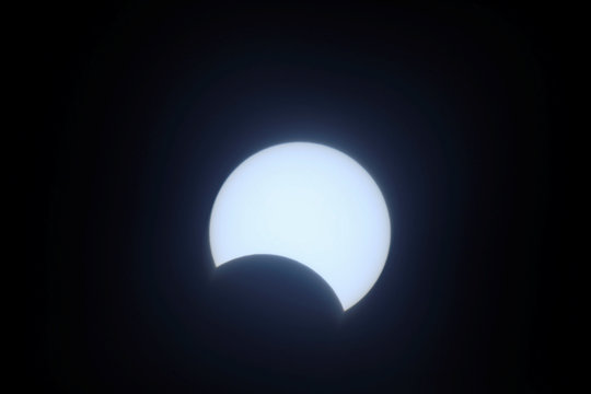 The moon passes between the sun and the earth during an annular solar eclipse in Madinat Zayed in the Al Dhafra region of Abu Dhabi