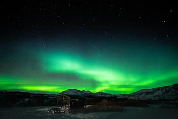 Foto auf Gartenposter Nordlicht Aurora Hut