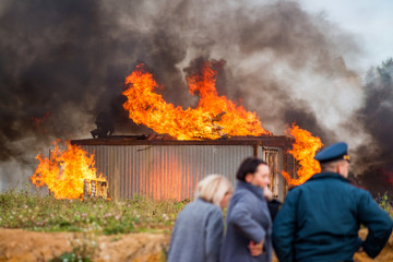 A building in fire. Training fire service to extinguish a fire, civil defense exercises