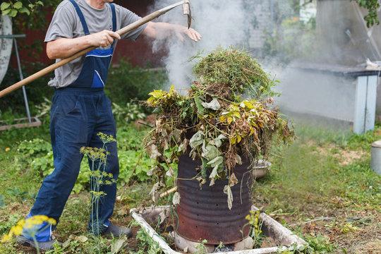 man firing grass in the garden