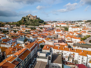 Wall Mural - Aerial view of Leiria with red roofs and castle on the hill, Portugal