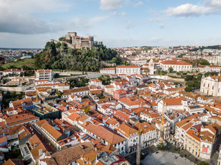 Aerial view of Leiria with red roofs and castle on the hill, Portugal