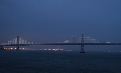 Fototapete - Night on the Bay Bridge in San Francisco