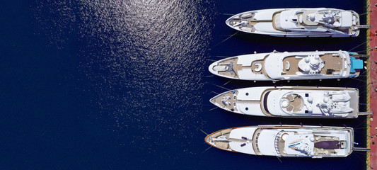 Wall Murals Ship Aerial drone top down ultra wide photo of Mediterranean port with yachts docked