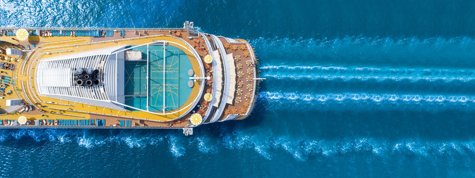 Aerial view of beautiful white cruise ship above luxury cruise close up at stern of cruise sail with contrail in the ocean sea  concept tourism travel on holiday take a vacation time on summer.