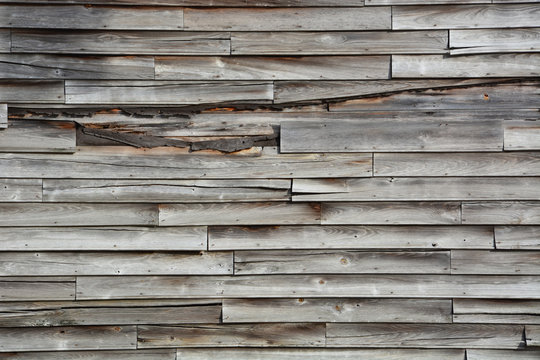 Weathered wood siding on an abandoned rural general store