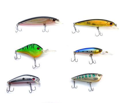 Voblers isolated on a white background. Composition of voblers. Set of voblers. Set of fish lures with hooks. The composition of the fisherman. Set of lures for spinning. Plastic fish with hooks.