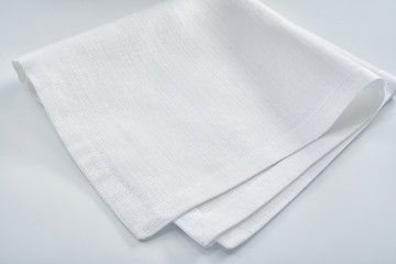 White linen napkin on a white table