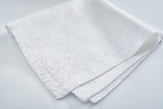 White linen napkin on a white table
