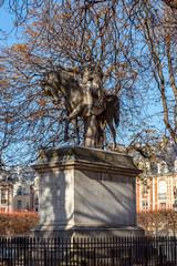 Equestrian statue of Louis XIII by Jean-Pierre Cortot (1787-1843) - Place des Vosges in autumn, Paris, France