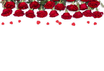 Decoration of Valentine Day. Beautiful flowers red roses and red hearts with space for text on...