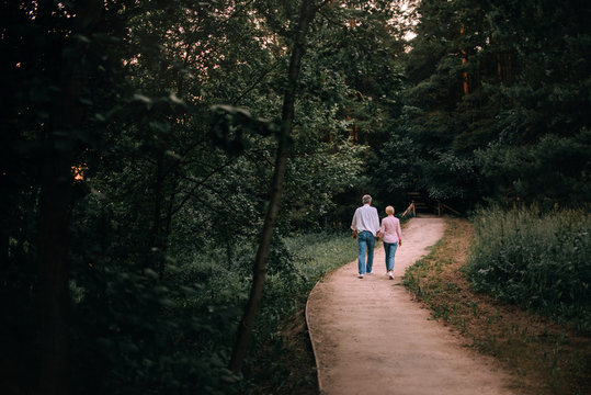 middle age couple walking in the park in summer