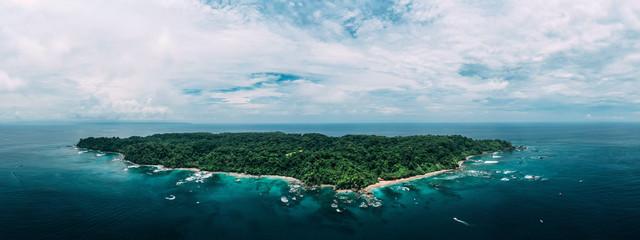 Foto auf AluDibond Insel Aerial Drone View of a tropical island with lush jungle in Costa Rica, Isla del Caño