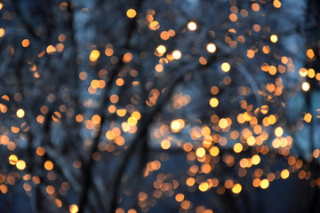 Golden light blur background stock images. Christmas lights in the city stock images. Elegant holiday background. Gold blurred bokeh wallpaper. Festive blur backdrop. Glossy golden background
