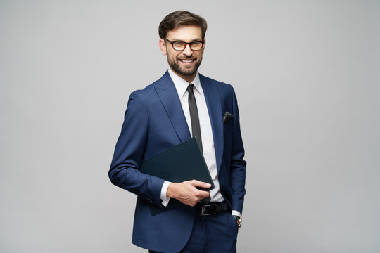 Portrait of a handsome young business man holding document folder