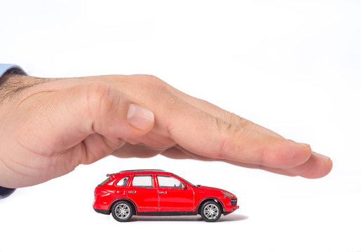 Time-worn car.Car (automobile) insurance and collision damage waiver concepts. Businessman with protective gesture