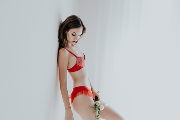 beautiful woman in red underwear with flowers fashion portrait