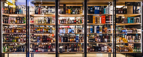 Melbourne, Victoria, Australia, November 23rd 2019: Several rows of bottles of alcoholic drinks on display in a retail window