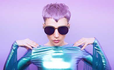 Futuristic model with violet hair. Trendy haircut
