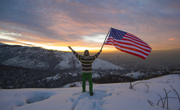 winter traveler in the mountains with USA flag