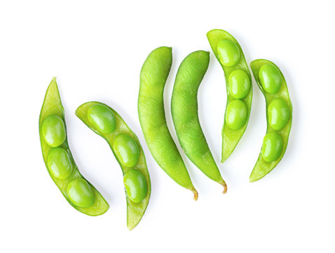 green soybeans on white background.