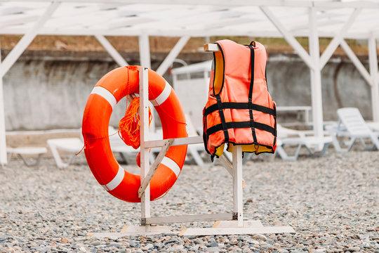 life buoy on the beach and life jacket