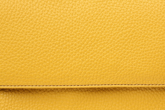 Yellow leather background and texture. Background of natural dyed leather