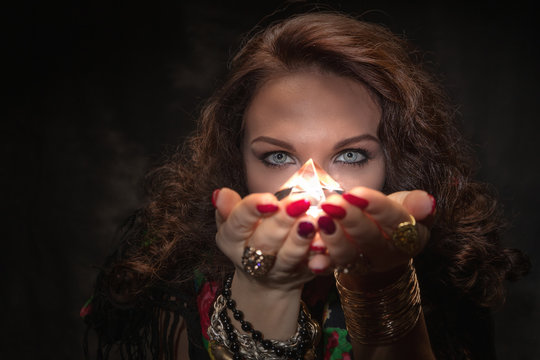 Fortune teller with a magic stone. Romantic magic. Palmistry. Clairvoyance