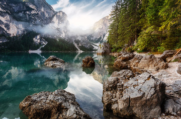 Fotomurales - Incredible Nature Landscape. Braies Lake in Dolomites mountains with mornitg fog, Dolomite. Italy. Italian lake landscape
