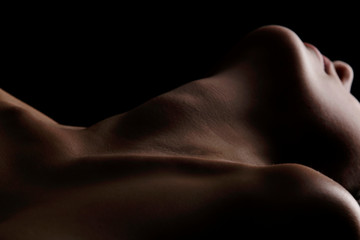 Sensual picture of woman's neck. Nude photography with visible collarbones.