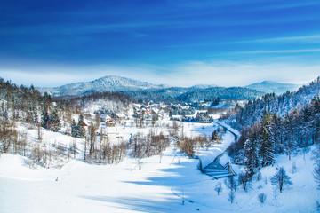 Printed kitchen splashbacks Blue sky Winter in Croatia, Countryside landscape in winter, panoramic view of small town of Lokve under snow in Gorski kotar