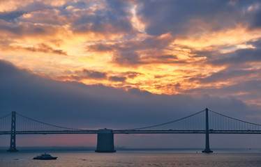 Fototapete - Bay Bridge at Sunrise with Ferry in Foreground