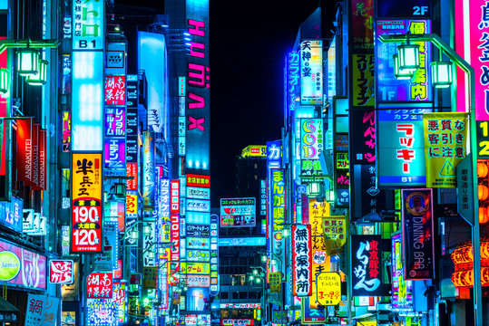 Tokyo, Japan -  - November 13, 2014: Billboards in Shinjuku's Kabuki-cho district. The area is a nightlife district known as Sleepless Town.