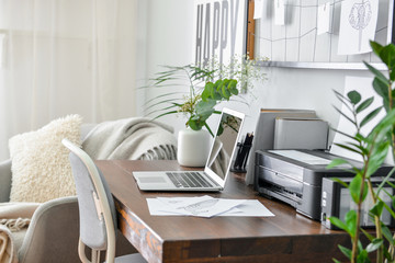 Comfortable workplace with laptop in modern room