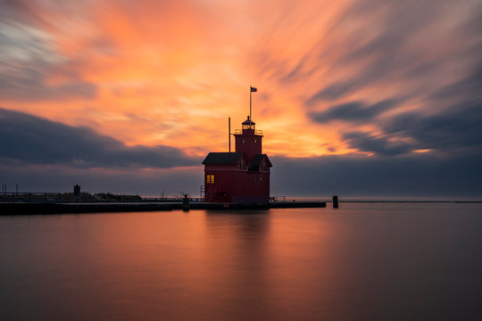 """The Holland Harbor Lighthouse at the entrance of a channel connecting Lake Michigan and Lake Mactawa. Built in 1907, it is commonly referred to as """"the Big Red."""""""