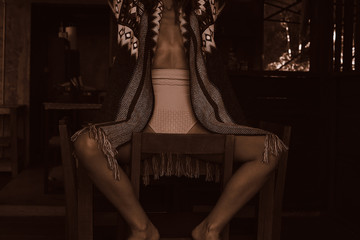 Human, beauty, art concept. Close up fragments of woman's body, drinking tea on wooden terrace. Sepia toned authentic artistic shot of cropped female taking a rest outdoors. Social networks content. Fototapete